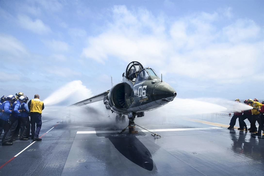 Sailors hose down an AV-8B Harrier during a flight deck fire drill aboard the USS Essex in the Pacific Ocean, May 9, 2017, as the amphibious assault ship conducts sea trials off the coast of Southern California. Navy photo by Petty Officer 3rd Class Chandler Harrell