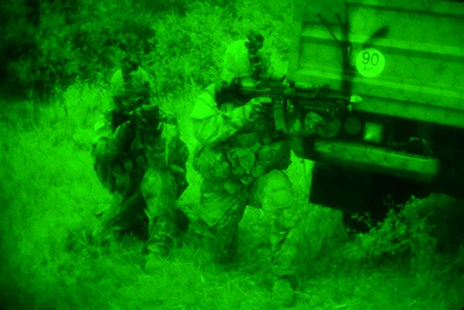 As seen through a night-vision lens, U.S. and Greek soldiers participate in a night raid on an enemy camp during Bayonet-Minotaur Exercise in Thessaloniki, Greece, May 17, 2017. The U.S. soldiers are assigned to the 1st Battalion, 503rd Infantry Regiment, 173rd Airborne Brigade and are regularly stationed in Italy. The Greek soldiers are assigned to the 1st Paratrooper Commando Brigade of the Greek army. Bayonet-Minotaur is a bilateral training exercise focused on enhancing NATO operational standards and developing individual technical skills. Army photo by Graigg Faggionato