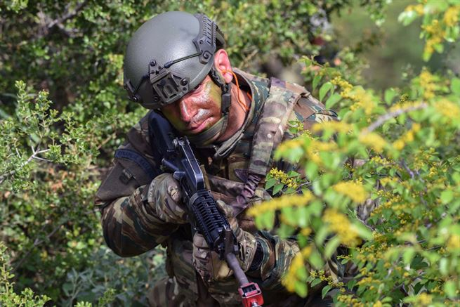 A Greek soldier scans his sector during a raid on an enemy campsite, as a part of Exercise Bayonet Minotaur in Thessaloniki, Greece, May 17, 2017. The U.S. soldiers participating are assigned to Company B, 1st Battalion, 503rd Infantry Regiment, 173rd Airborne Brigade and are regularly stationed in Italy. The Greek soldiers are assigned to the 1st Paratrooper Commando Brigade of the Greek army. Bayonet-Minotaur is a bilateral training exercise focused on enhancing NATO operational standards and developing individual technical skills. Army photo by Staff Sgt. Philip Steiner