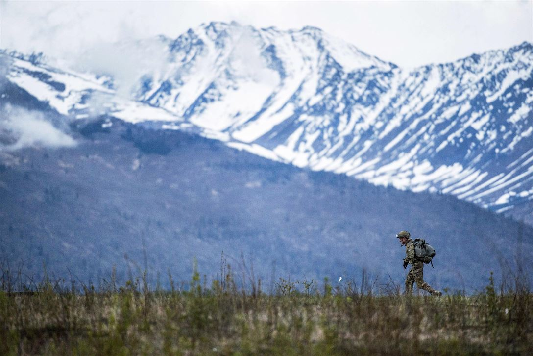 An Air Force tactical air control party specialist proceeds to a rally point after conducting airborne jump training at the Malemute drop zone at Joint Base Elmendorf-Richardson, Alaska, May 18, 2017. The airman is assigned to the 3rd Air Support Operations Squadron. Air Force photo by Alejandro Pena