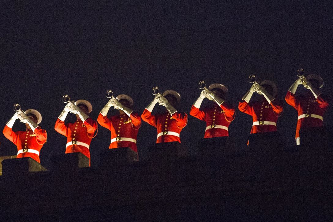 U.S. Marine Drum and Bugle Corps members give a rooftop performance during an evening parade at Marine Barracks Washington, D.C., May 29, 2017. The parades honor senior officials, distinguished citizens and supporters of the Marine Corps. Marine Corps photo by Lance Cpl. Alex A. Quiles
