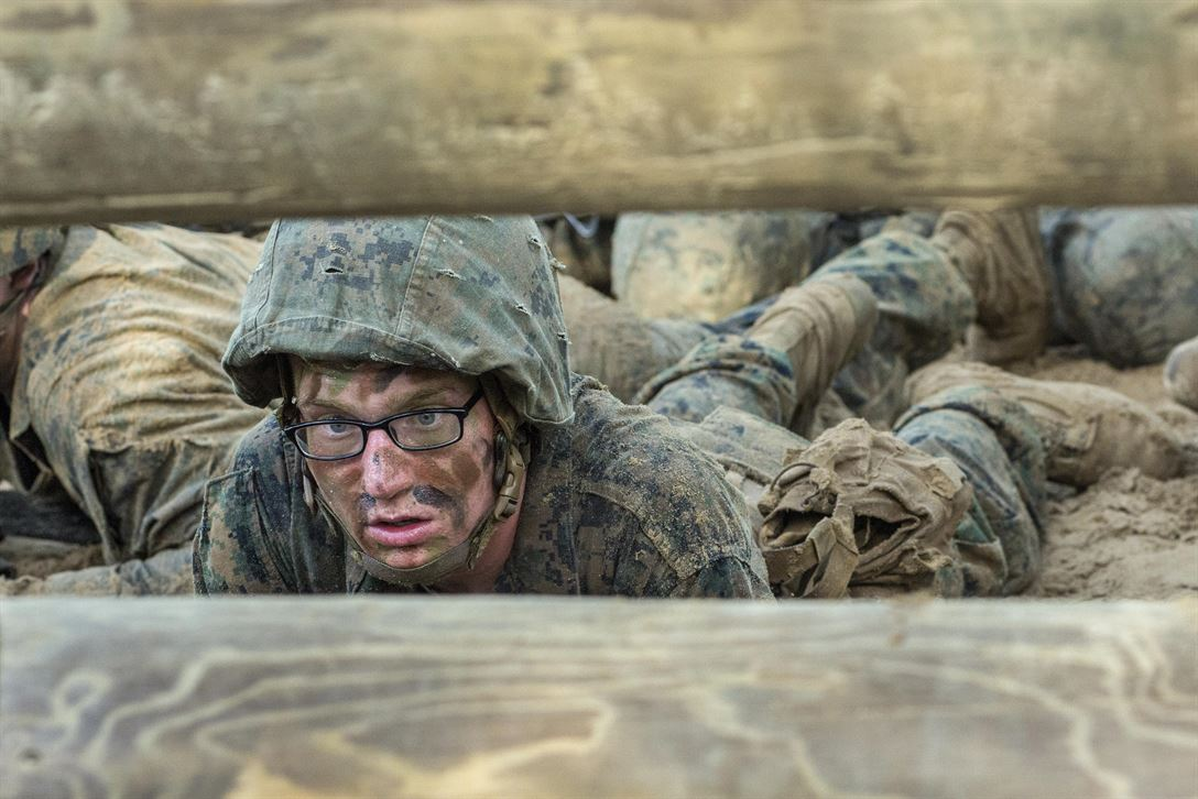 Marine Corps recruit Robbin Anderson low-crawls while going through the combat endurance course at Marine Corps Recruit Depot Parris Island, S.C., May 20, 2017. The course includes a 2.5-mile run with obstacles along the way designed to improve small-unit leadership among recruits. Marine Corps photo by Cpl. Richard Currier