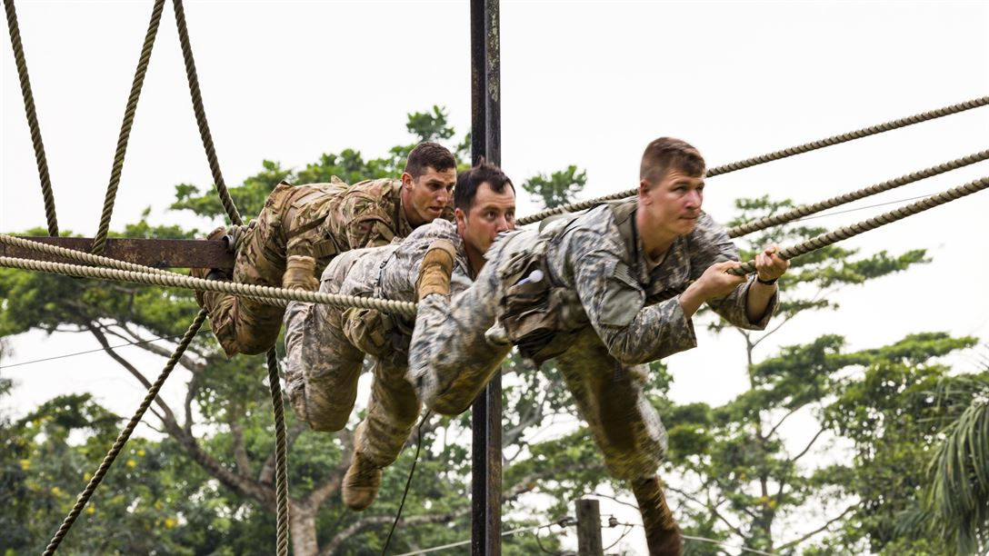 Soldiers climb across a rope during United Accord 2017 at the Jungle Warfare School in Achiase military base in Akim Oda, Ghana, May 20, 2017. The school provides a series of exercises to train participants in counterinsurgency and internal security operations. Army photo by Spc. Victor Perez Vargas