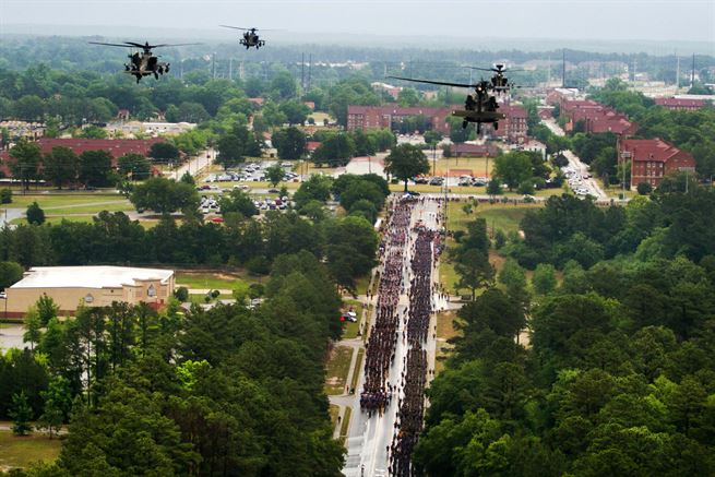 Paratroopers assigned to the 82nd Airborne Division participate in a division run while UH-60 Black Hawk and AH-64 Apache helicopters fly overhead during All American Week at Fort Bragg, N.C., May 22, 2017. Army photo by Spc. Houston Graham