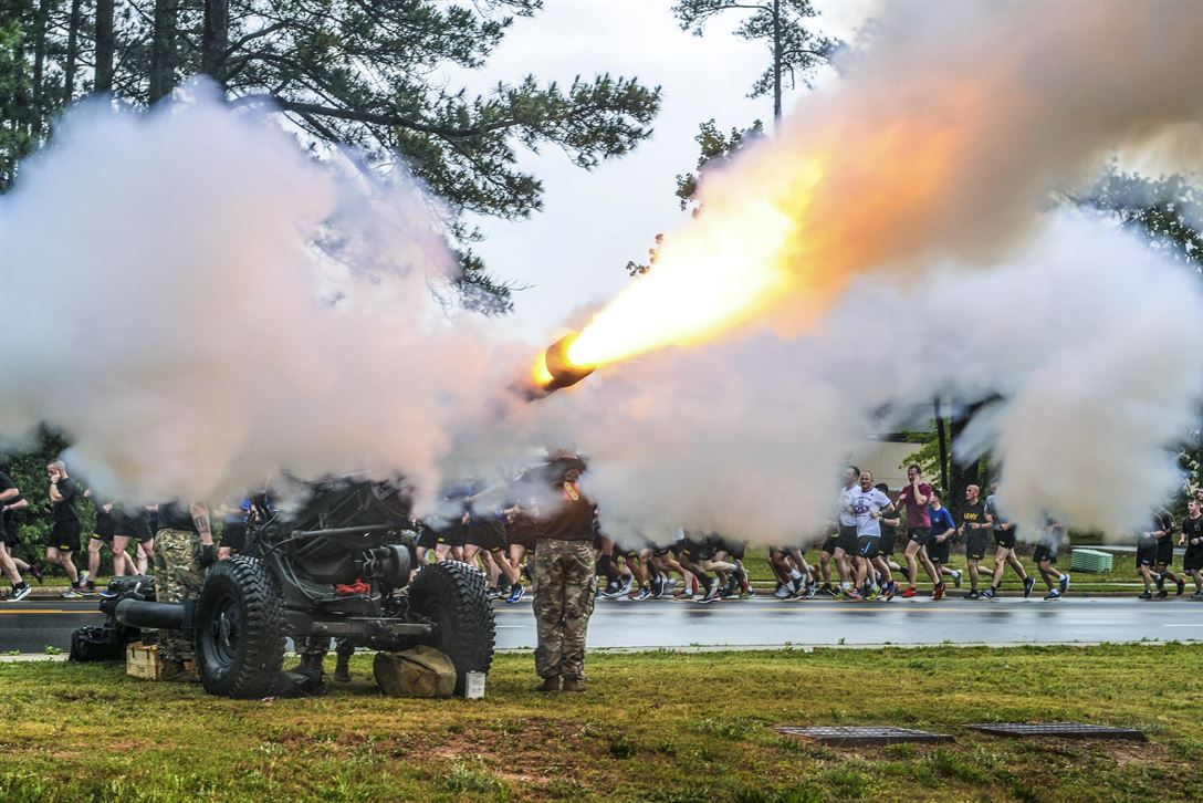 Paratroopers fire an M119 howitzer during the All American Week division run at Fort Bragg, N.C., May 22, 2017. The event celebrates the 82nd Airborne Division with events for soldiers and veterans of the division. Army photo by Sgt. Anthony Hewitt