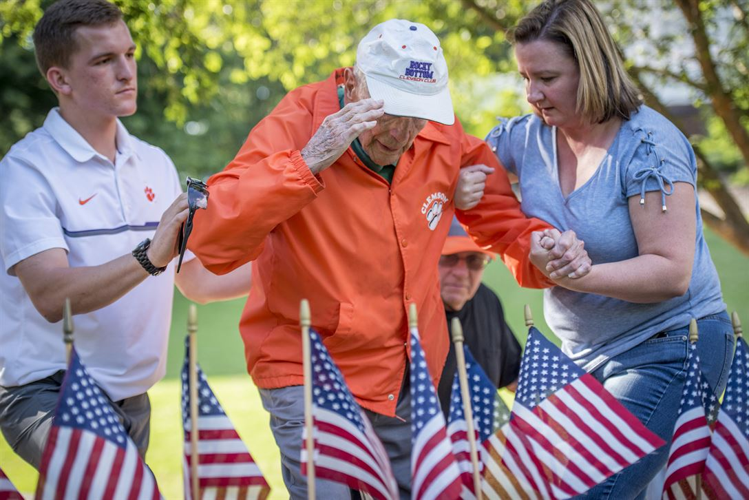 Retired Army Col. Ben Skardon, 99, a survivor of the Bataan Death March, salutes Henry Leitner's headstone in Clemson University's Scroll of Honor during a flag-placing ceremony in preparation for Memorial Day observances, May 25, 2017. Leitner and Skardon, both Clemson alumni, survived the infamous Bataan Death March and were prisoners of war together. Army Reserve photo by Staff Sgt. Ken Scar