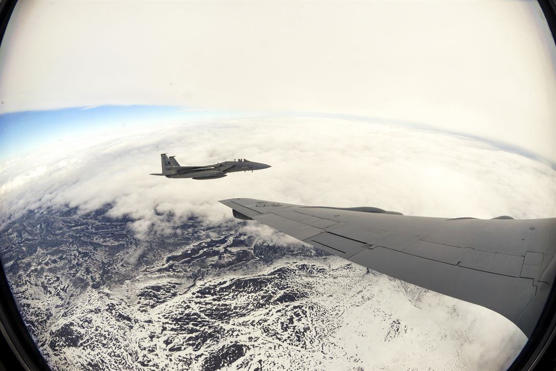 An Air Force F-15E Strike Eagle flies alongside an Air Force KC-135 Stratotanker after an aerial refueling over Finland, May 25, 2017. The aircraft are participating in Arctic Challenge 2017, a multinational exercise encompassing 11 nations and more than 100 aircraft. Air Force photo by Tech. Sgt. David Dobrydney