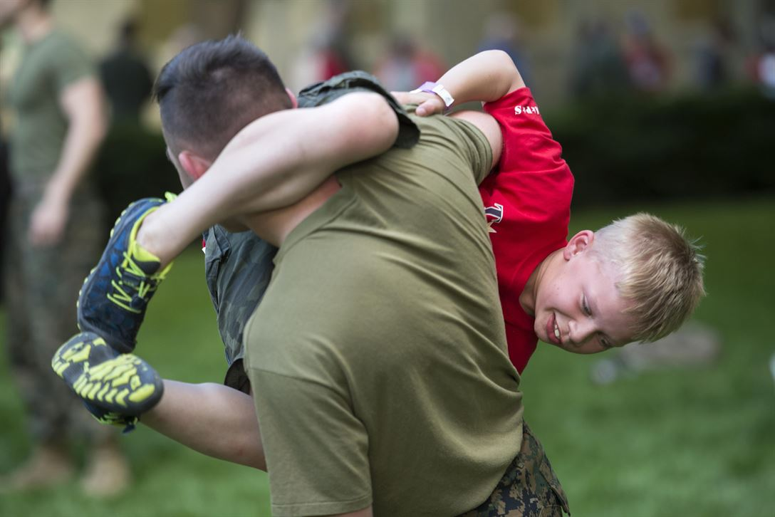 Seven-year-old Orion Clarkson tries to tackle Marine Cpl. Skylar Heidrich during a Marine martial arts demonstration for the Tragedy Assistance Program for Survivors night at the Pentagon, May 26, 2017. DoD photo by EJ Hersom