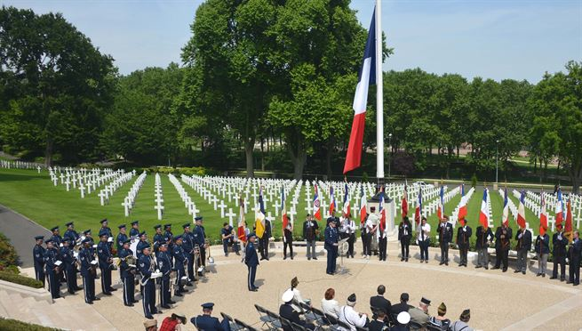 Air Force Gen. Tod D. Wolters, center, commander of U.S. Air Forces in Europe and Air Forces Africa, speaks at a Memorial Day ceremony at the American cemetery in Suresnes, France, May 28, 2017. This Memorial Day marks the centennial of U.S. entry into World War I. Air Force photo by Capt. Ben Sowers