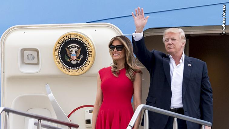 President Trump and First Lady Melania Trump wave to a crowd from Air Force One.