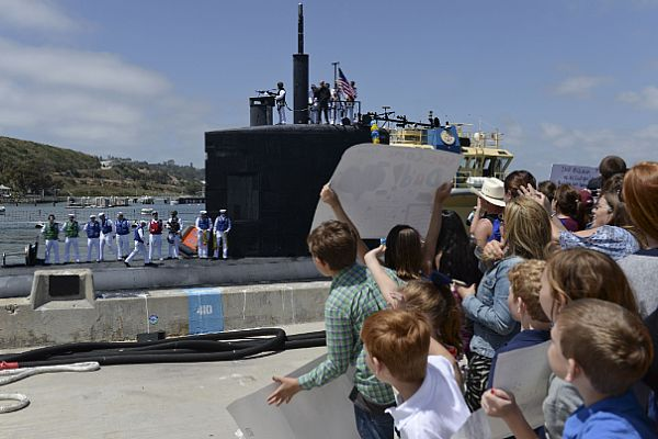 Family and friends welcome back the crew of the Los Angeles-class fast attack submarine USS Alexandria (SSN 757).