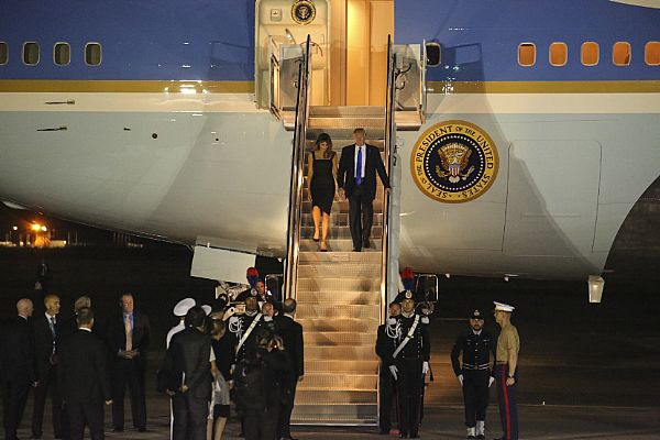 President Donald Trump and First Lady Melania Trump exit Air Force One at Naval Air Station Sigonella, Sicily.