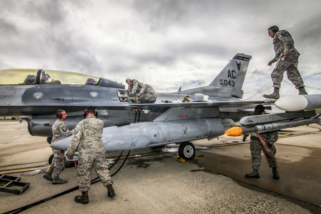 Maintenance airmen prepare an F-16D Fighting Falcon for a training mission during the 2017 CrossTell event, an air intercept exercise, at Atlantic City Air National Guard Base, N.J., May 24, 2017. The airmen are assigned to the New Jersey Air National Guard's 177th Fighter Wing. Air National Guard photo by Master Sgt. Matt Hecht