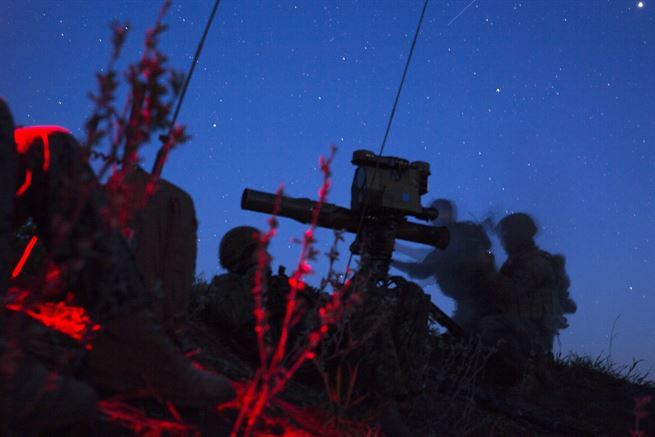 U.S. Marines and Canadian soldiers search for possible enemy targets at night before engaging them with a rocket launcher during exercise Maple Resolve 17 at Camp Wainwright, Alberta, Canada, May 26, 2017. Marine Corps photo by Cpl. Gabrielle Quire