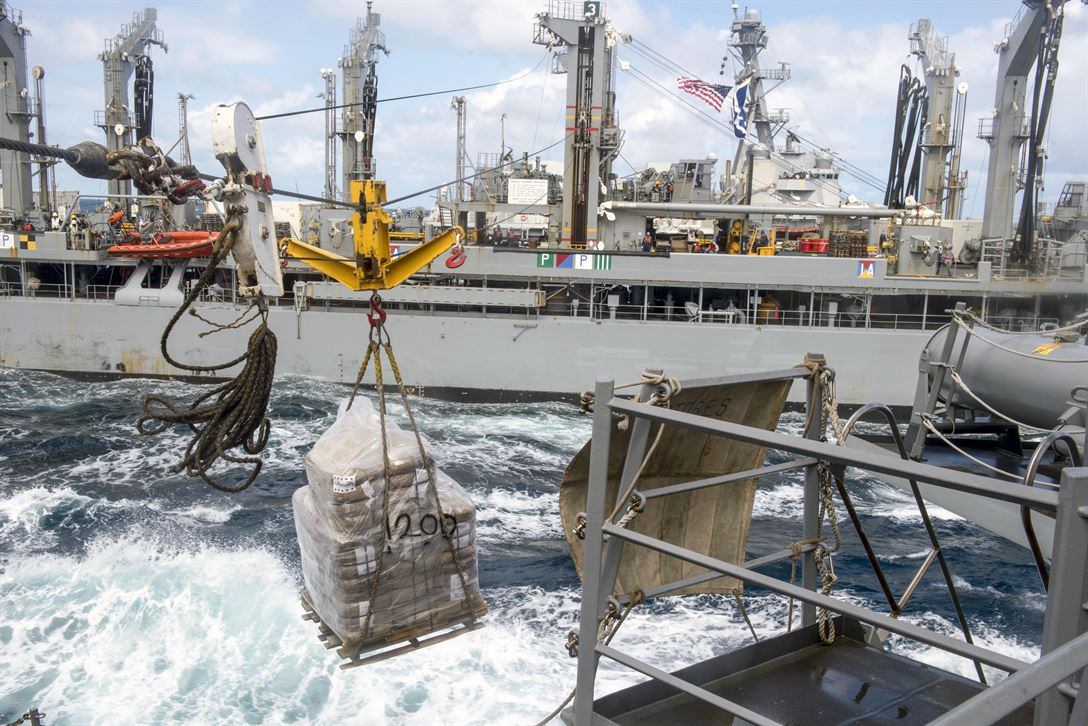 The guided-missile destroyer USS Mustin receives a pallet of supplies from the fleet replenishment oiler USNS Rappahannock during an underway replenishment in the Sea of Japan, May 26, 2017. The Mustin is on patrol supporting security and stability in the Indo-Asia-Pacific region. Navy photo by Petty Oficer 2nd Class William Collins III