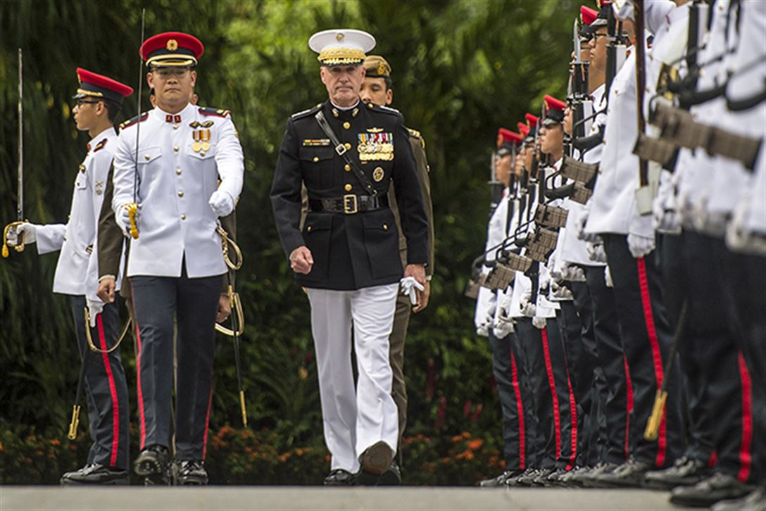 Marine Corps Gen. Joe Dunford, chairman of the Joint Chiefs of Staff, inspects an honor guard in Singapore, June 2, 2017. Dunford is in Singapore to attend the Shangri-La Dialogue, an Asia-focused defense summit, where he will meet with regional allies and counterparts to discuss common security issues. DoD photo by Navy Petty Officer 2nd Class Dominique A. Pineiro