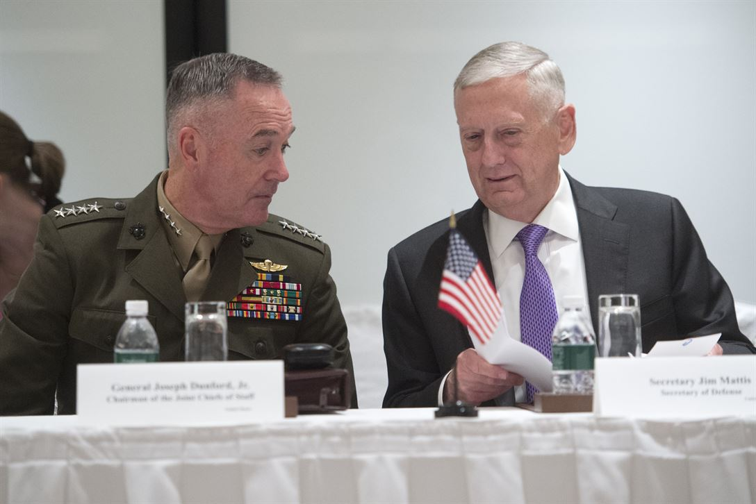 Defense Secretary Jim Mattis and Marine Corps Gen. Joe Dunford, chairman of the Joint Chiefs of Staff, consult while meeting with members of the Australian and Japanese defense delegation during the Shangri-La Dialogue in Singapore, June 3, 2017. DoD photo by Navy Petty Officer 2nd Class Dominique A. Pineiro