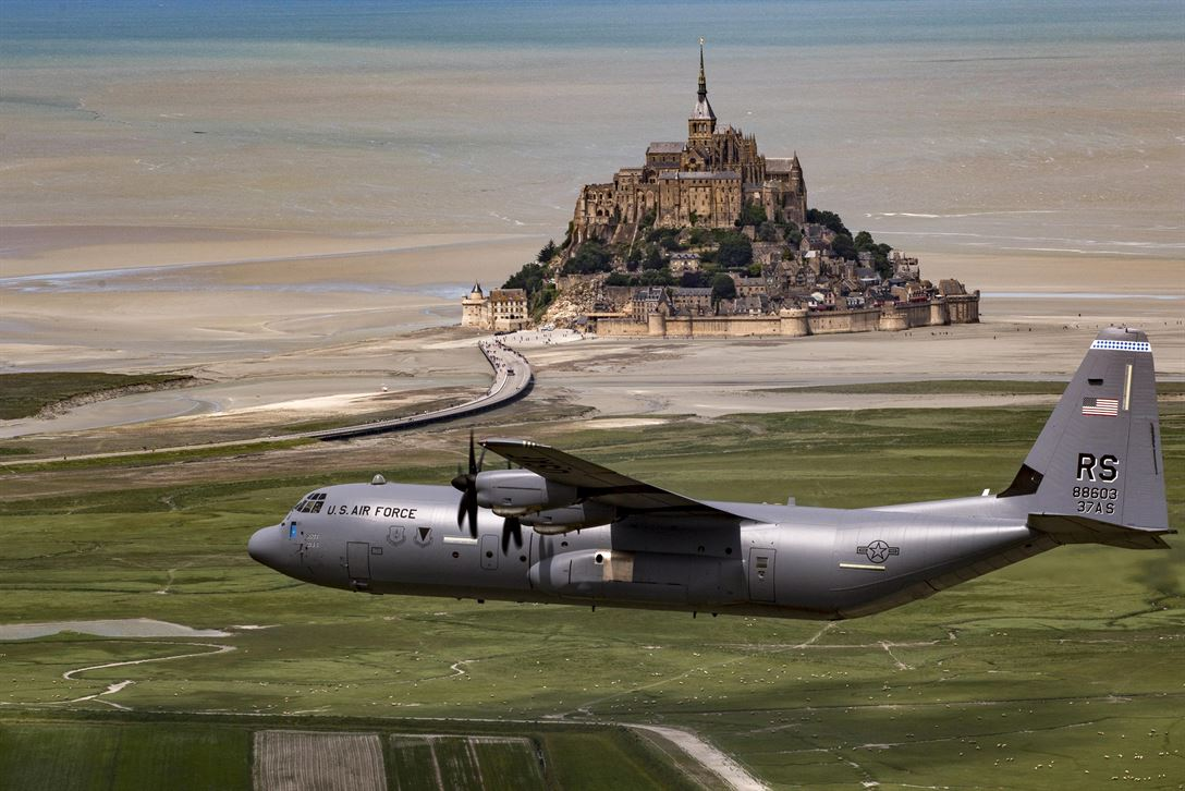 Air Force Brig. Gen. Richard G. Moore Jr. flies a C-130J Super Hercules past Mont Saint-Michel in Normandy, France, June 3, 2017, during an event commemorating the 73rd anniversary of D-Day. Moore is commander of the 86th Airlift Wing. Air Force photo by Senior Airman Devin Boyer