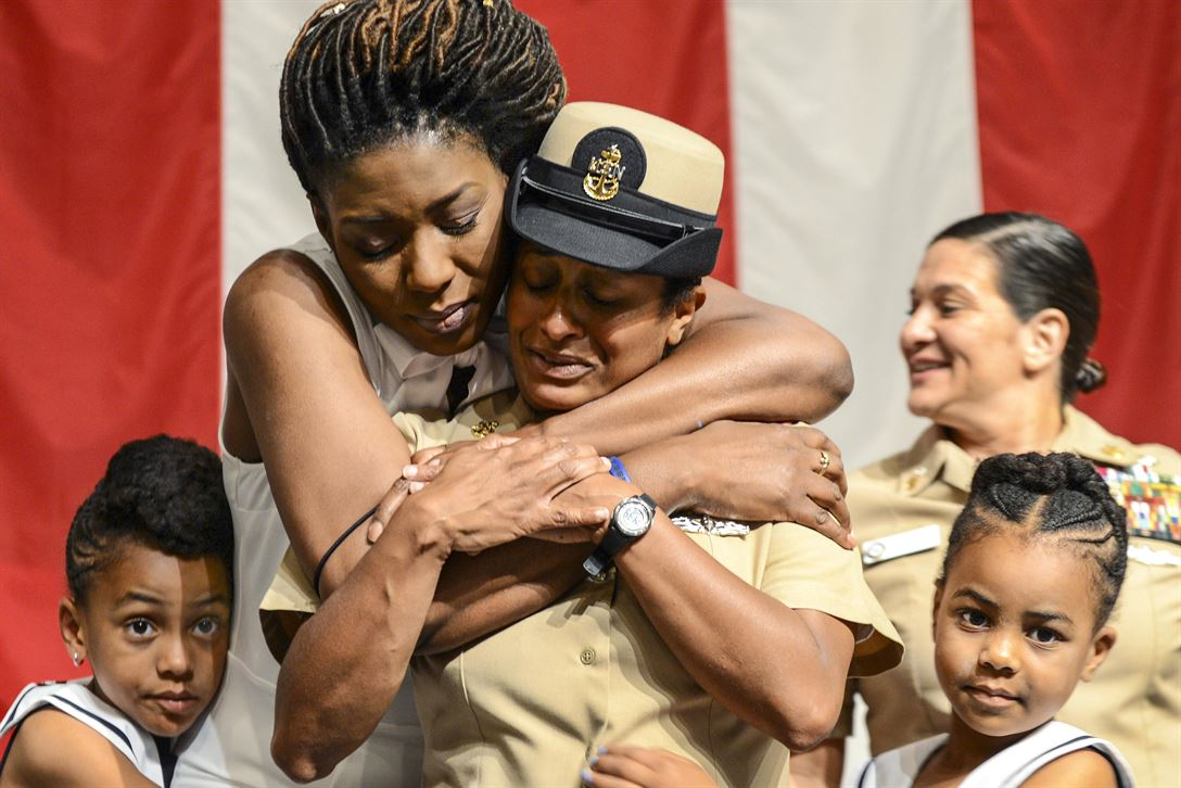 Family members of Navy Senior Chief Petty Officer Latoya Bauman embrace her after she is pinned during a senior chief pinning ceremony at Naval Support Activity Mid-South in Millington, Tenn., June 7, 2017. Bauman is an information systems technician. Navy photo by Chief Petty Officer Dustin Kelling