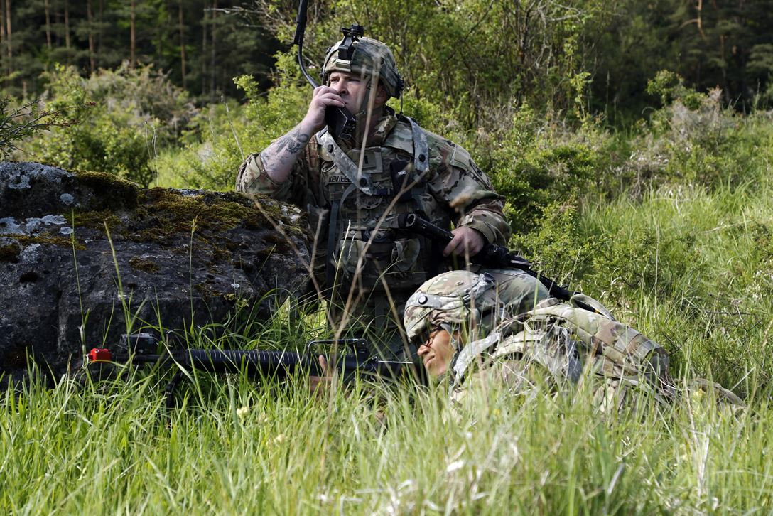 A soldier assigned to 1st Battalion, 501st Aviation Regiment, transmits information via field radio during Exercise Combined Resolve VIII at Hohenfels Training Area, Germany, June 8, 2017. Exercise Combined Resolve VIII is a multinational exercise designed to train the Army's Regionally Allocated Force for the U.S. European Command. The exercise will include more than 3,400 participants from 10 nations. The goal of the exercise is to prepare forces in Europe to operate together to promote stability and security in the region. Army photo by Spc. Michael Bradley
