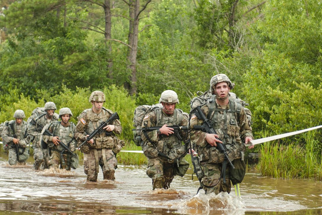 Soldiers cross a water obstacle at the end of an early morning 10-kilometer ruck march during the 2017 Army Reserve Best Warrior Competition at Fort Bragg, N.C., June 13. The competition determines the top noncommissioned officer and junior enlisted soldier who will represent the Army Reserve in the Department of the Army Best Warrior Competition later in the year. Army photo by Sgt. David Turner