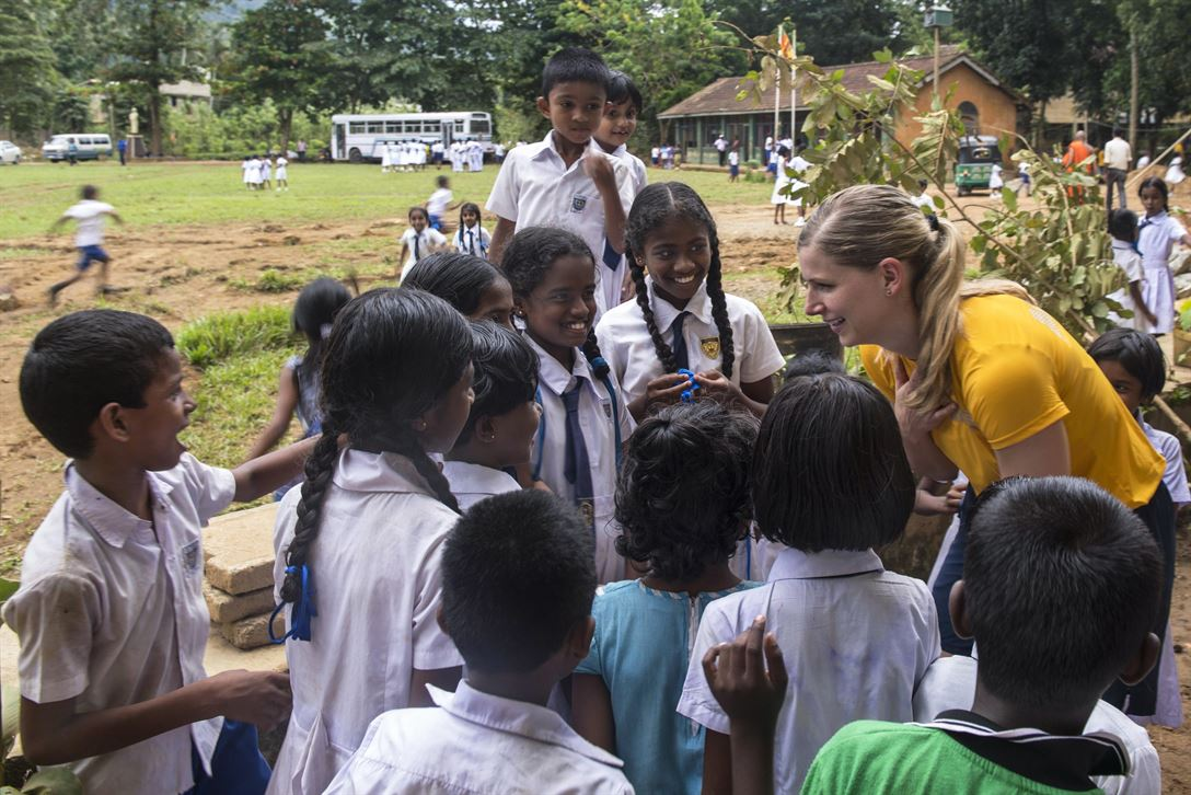 Navy Lt. Christina Appleton greets children attending the Mallika Nawodya School in Galle, Sri Lanki, June 14, 2017. Appleton is assigned to the USS Lake Erie, which arrived at the school to support humanitarian assistance operations following severe flooding and landslides in the country. Navy photo by Petty Officer 3rd Class Lucas T. Hans