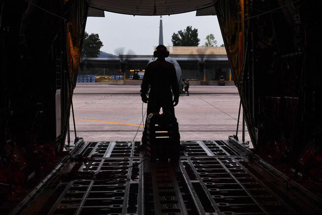 Air Force Master Sgt. CJ Campbell watches aircrew members ready a C-130J Super Hercules for departure during Exercise Stolen Cerberus IV at Elefsis Air Base, Greece, April 21, 2017. Campbell and other loadmasters prepared three C-130s for personnel and cargo drops. As NATO allies, the U.S. and Greece share a commitment to promote peace and stability and seek opportunities to continue developing their strong relationship. Campbell is a aircraft loadmaster assigned to the 37th Airlift Squadron. Air Force photo by Senior Airman Tryphena Mayhugh