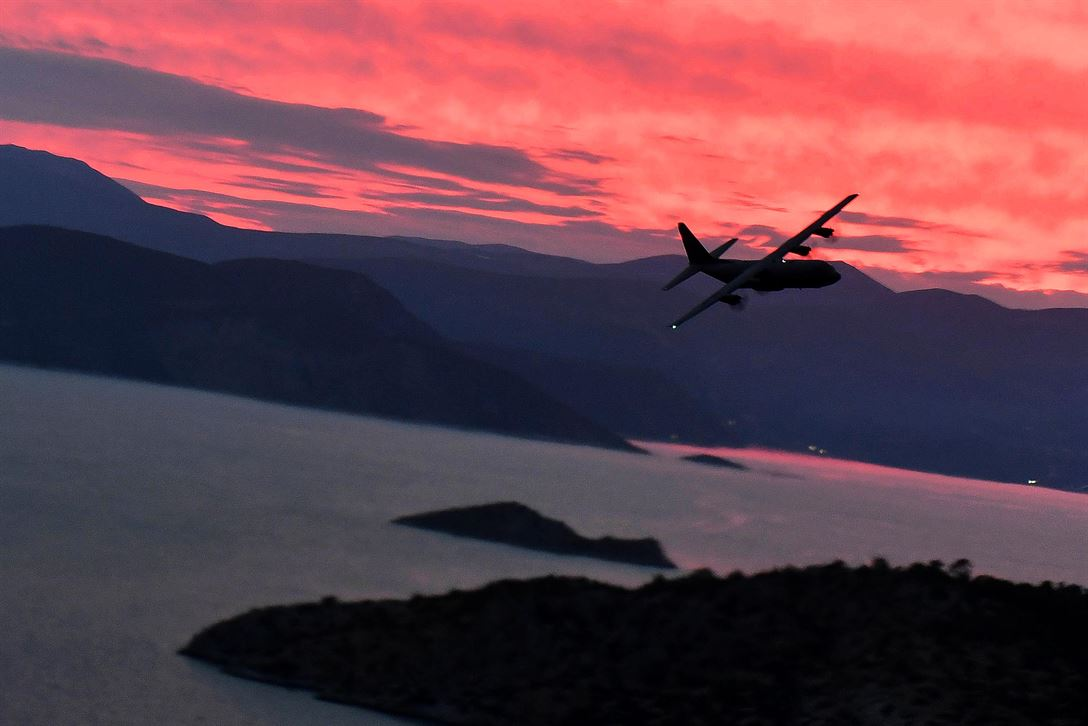 A Air Force C-130J Super Hercules flies above the Greek coastline during Exercise Stolen Cerberus IV near Elefsis Air Base, Greece, April 21, 2017. Approximately 110 U.S. airmen and three C-130s from the 86th Airlift Wing's 37th Airlift Squadron, Ramstein Air Base, Germany, participated in the exercise. Air Force photo by Senior Airman Tryphena Mayhugh