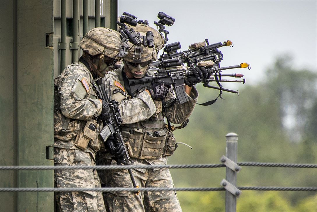 Army Rangers prepare to enter a building during a demonstration at the 6th Ranger Training Battalion's open house at Eglin Air Force Base, Fla., April 29, 2017 The event showed hand-to-hand combat, a parachute jump, snake show and Rangers in action. Air Force photo by Samuel King Jr.