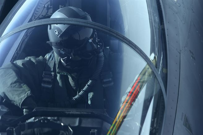 An Air Force F-15E Strike Eagle weapon systems officer watches as a KC-10 Extender aircraft prepares to conduct in-flight refueling during the Northern Edge 2017 exercise over Joint Base Elmendorf-Richardson, Alaska, May 4, 2017. Air Force photo by Staff Sgt. Westin Warburton