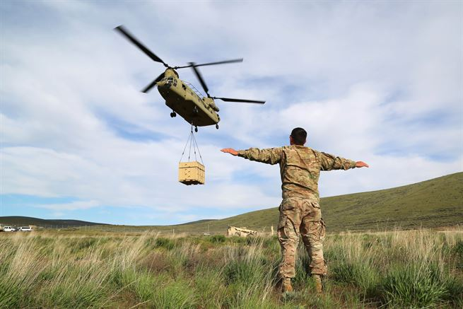 Army Staff Sgt. Keith Beardsley signals a CH-47 Chinook helicopter to hover during a slingload operation, part of Exercise Dragon Fire, at the Yakima Training Center, Yakima, Wash., May 5, 2017. Beardsley is an air assault instructor from the Phantom Warrior Academy. Army photo by Sgt. Kalie Jones