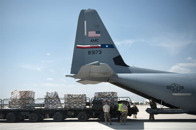 Airmen prepare to load cargo onto a C-130J Super Hercules aircraft at Bagram Airfield, Afghanistan, May 5, 2017. The airmen are deployed from Dyess Air Force Base, Texast. Air Force photo by Staff Sgt. Benjamin Gonsier