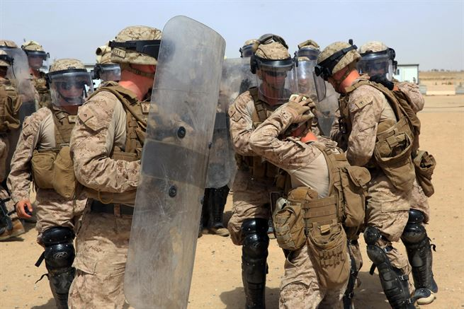 Marines confront a simulated aggressor during a nonlethal weapons training in Jordan, May 9, 2017. The Marines are assigned to the 1st Battalion, 7th Marine Regiment, Special Purpose Marine Air-Ground Task Force. Marine Corps photo by Cpl. Kyle McNan
