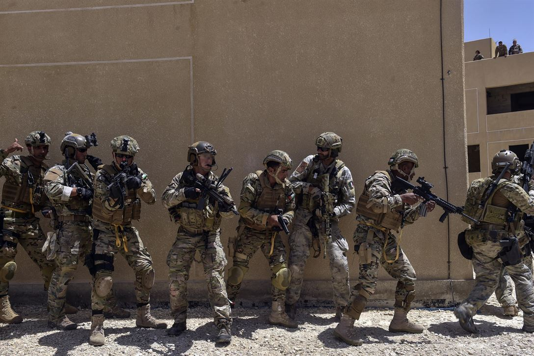 Air Force special tactics airmen, Italian special operations forces and members of the Jordanian Armed Forces Special Task Force conduct a simulated assault on a compound during exercise Eager Lion 17 at King Abdullah II Special Operations Training Center in Amman, Jordan, May 11, 2017. Air Force photo by Senior Airman Ryan Conroy