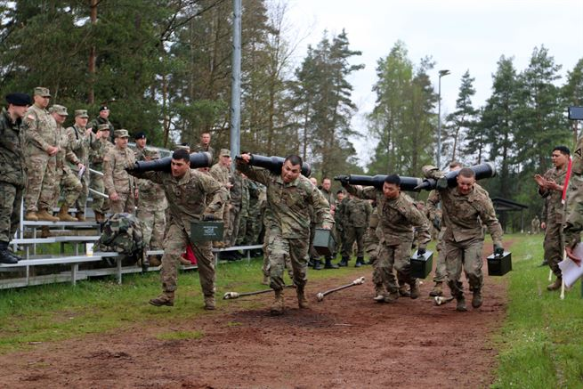 American soldiers compete against other nations in a relay race with tank-related objects in Grafenwoehr, Germany, May 12, 2017. The Strong Europe Tank Challenge is co-hosted by U.S. Army Europe and the German army, May 7-12, 2017. Army photo by Staff Sgt. Kathleen V. Polanco