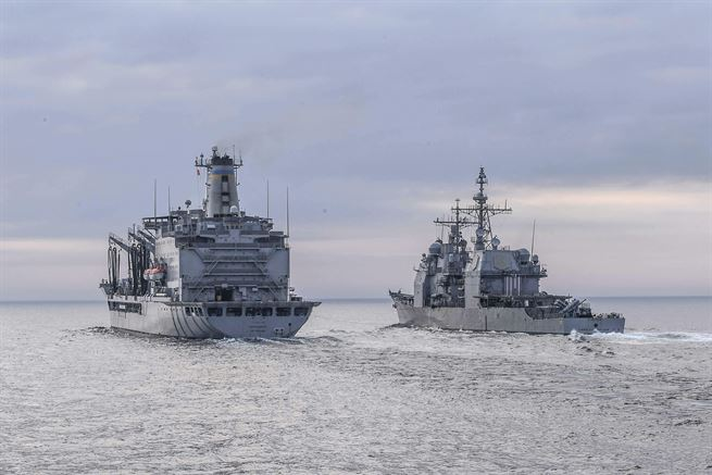 The Ticonderoga-class guided-missile cruiser USS Lake Champlain pulls alongside Henry J. Kaiser-class underway replenishment oiler USNS Rappahannock to receive fuel during a replenishment-at-sea in the western Pacific Ocean, May 13, 2017. Lake Champlain is on a regularly scheduled western Pacific deployment with the Carl Vinson Carrier Strike Group. Navy photo by Petty Officer 3rd Class Kelsey L. Adams