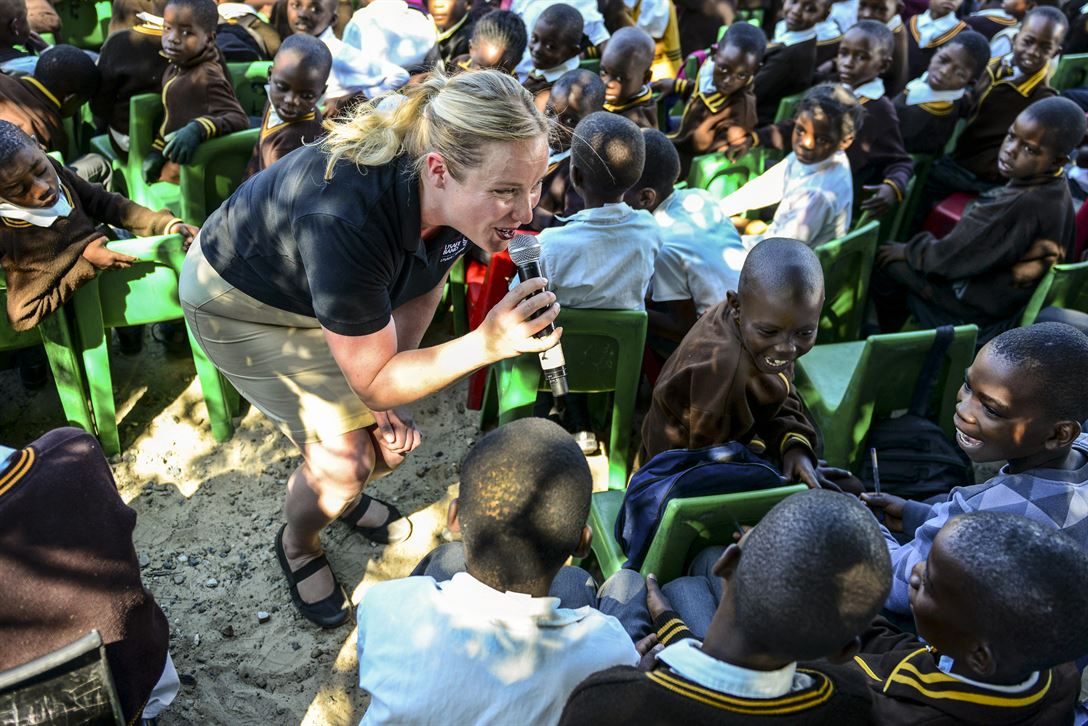 "Air Force Staff Sgt. Jill Diem, a vocalist with the U.S. Air Forces in Europe Band's ""Ambassadors Combo,"" performs for Kachikau Primary School students in Kachikau, Botswana, May 17, 2017, while supporting the 2017 African Air Chiefs Symposium. Air Force photo by Staff Sgt. Krystal Ardrey"