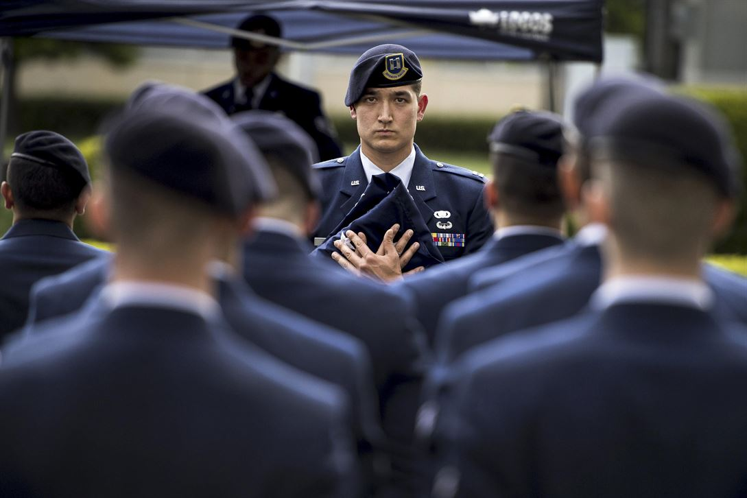 Air Force Capt. Michael F. Winter holds a ceremonial flag during a memorial retreat ceremony for fallen law enforcement members at Yokota Air Base, Japan, May 18, 2017. Winter is the commanding officer of the 374th Security Forces Squadron. Air Force photo by Airman 1st Class Donald Hudson