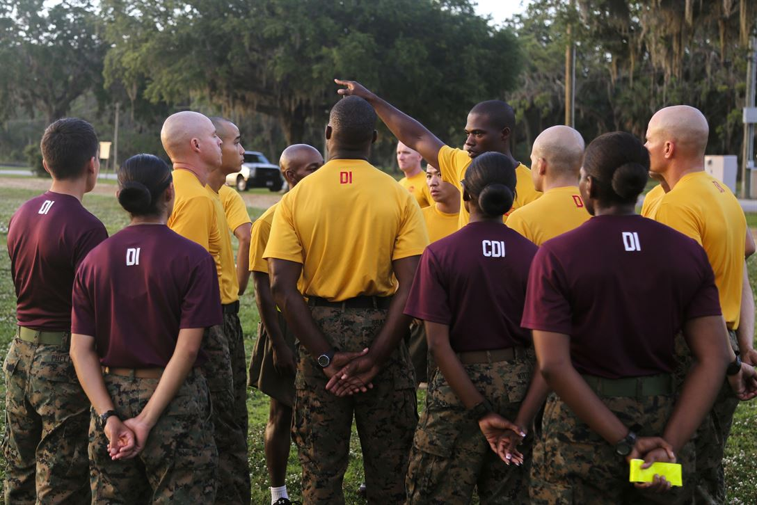 Marine Corps drill instructors receive a safety briefing before supervising recruits as they maneuver through an obstacle course at Marine Corps Recruit Depot Parris Island, S.C., May, 20, 2017. The drill instructors are assigned to Recruit Training Regiment's November Company, 4th Battalion and Hotel Company, 2nd Battalion. The obstacle course tested recruits' strength, agility and endurance. Marine Corps photo by Lance Cpl. Colby Cooper