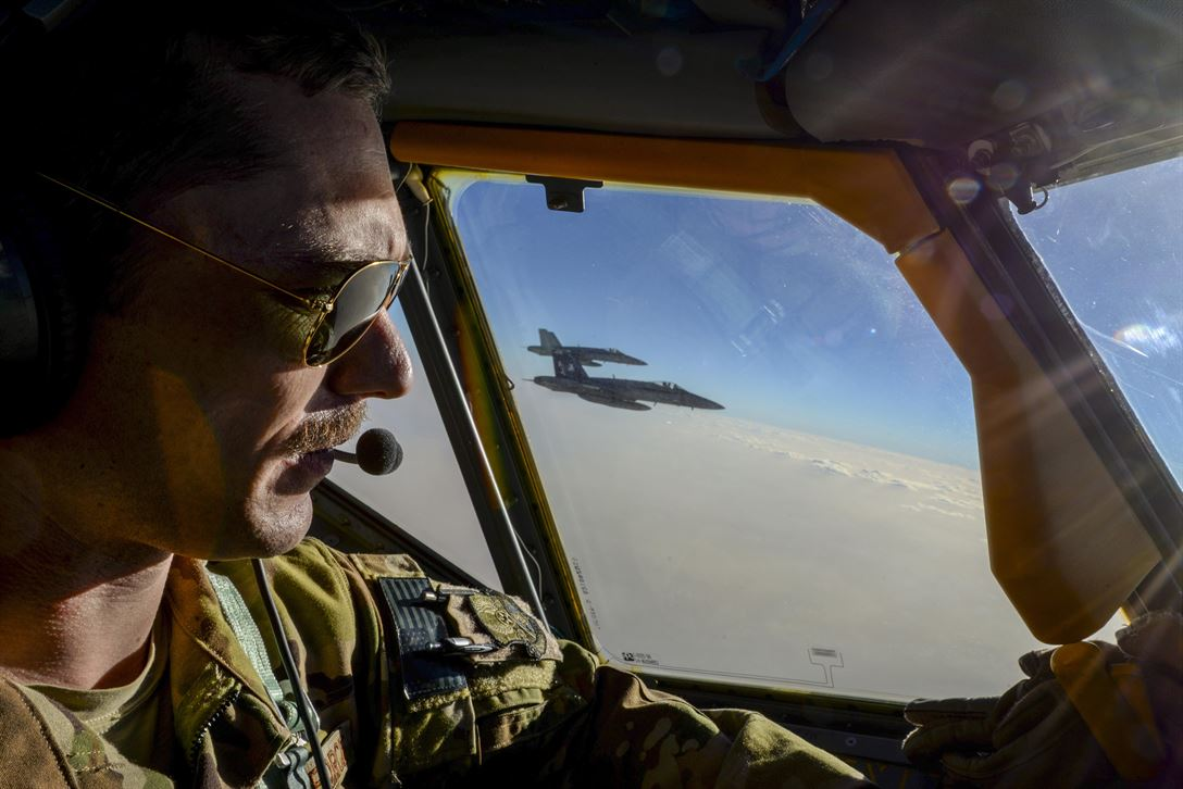 Air Force Capt. Timothy Black pilots a KC-135 Stratotanker on a combat refueling mission over Southwest Asia while two Navy F/A-18C Hornets fly alongside it, May 21, 2017. The Stratotanker is assigned to the 340th Expeditionary Air Refueling Squadron, which supports Operation Inherent Resolve. Air National Guard photo by Master Sgt. Andrew J. Moseley