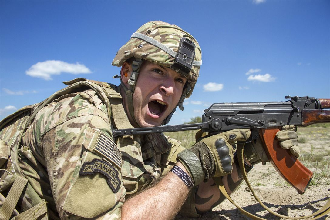 Army Sgt. Matthew Councill shouts commands to his team of Canadian soldiers during a U.S.-Canadian demonstration of a section attack for Ukrainian noncommissioned officers near Zhytomyr, Ukraine, May 22, 2017. Councill is assigned to the Joint Multinational Training Group Ukraine. Army photo by Sgt. Anthony Jones