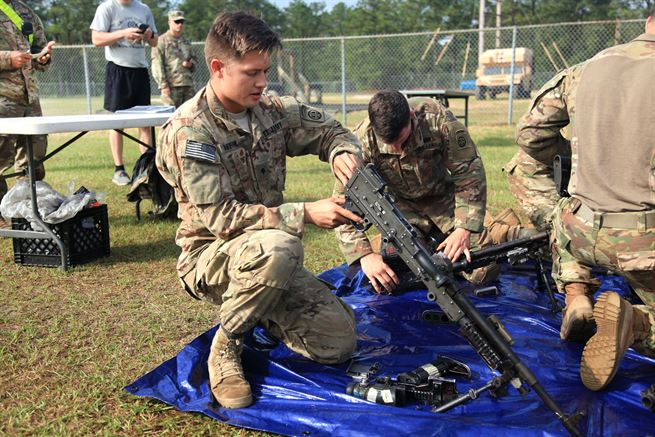 A paratrooper assigned to the 82nd Airborne Division assembles a machine gun while competing in the Best Squad Competition during All American Week at Fort Bragg, N.C., May 22, 2017. The competition is an All American Week tradition where squads compete on an obstacle course, a warrior skills lane, a combat lifesaver skills lane, and stress shoot for time. Army photo by Staff Sgt. Amber Stephens