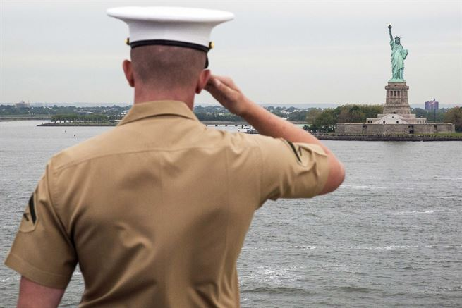 A Marine aboard the USS Kearsarge salutes the Statue of Liberty during the parade of ships as part of Fleet Week New York in New York , May 24, 2017. Marine Corps photo by Lance Cpl. Gloria Lepko