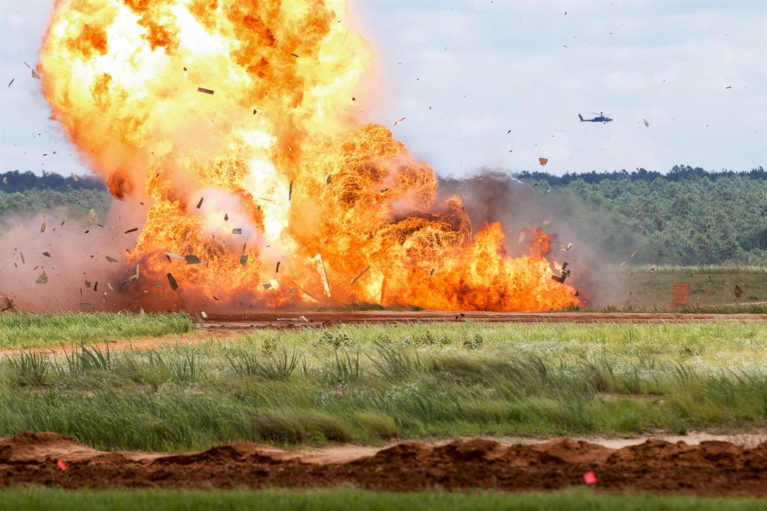 Paratroopers assigned to the 82nd Airborne Division detonate explosives during an airborne review at Fort Bragg, N.C., May 25, 2017. The review was the culminating event for All American Week, which celebrates the division. Army photo by Spc. Dustin D. Biven