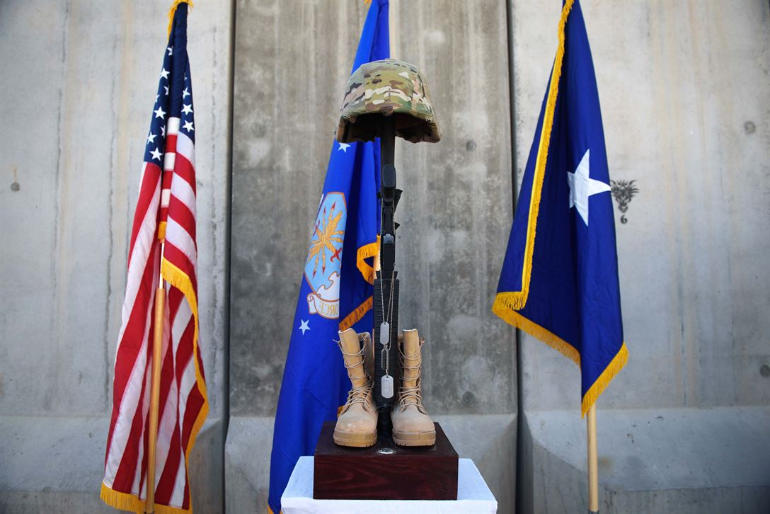 A battlefield cross is displayed during a Memorial Day ceremony at Bagram Airfield, Afghanistan, May 29, 2017. The boots, rifle and helmet make what is called the Battlefield Cross, which is a symbolic replacement of a cross and is used to honor and show respect to deceased service members. Air Force photo by Staff Sgt. Benjamin Gonsier