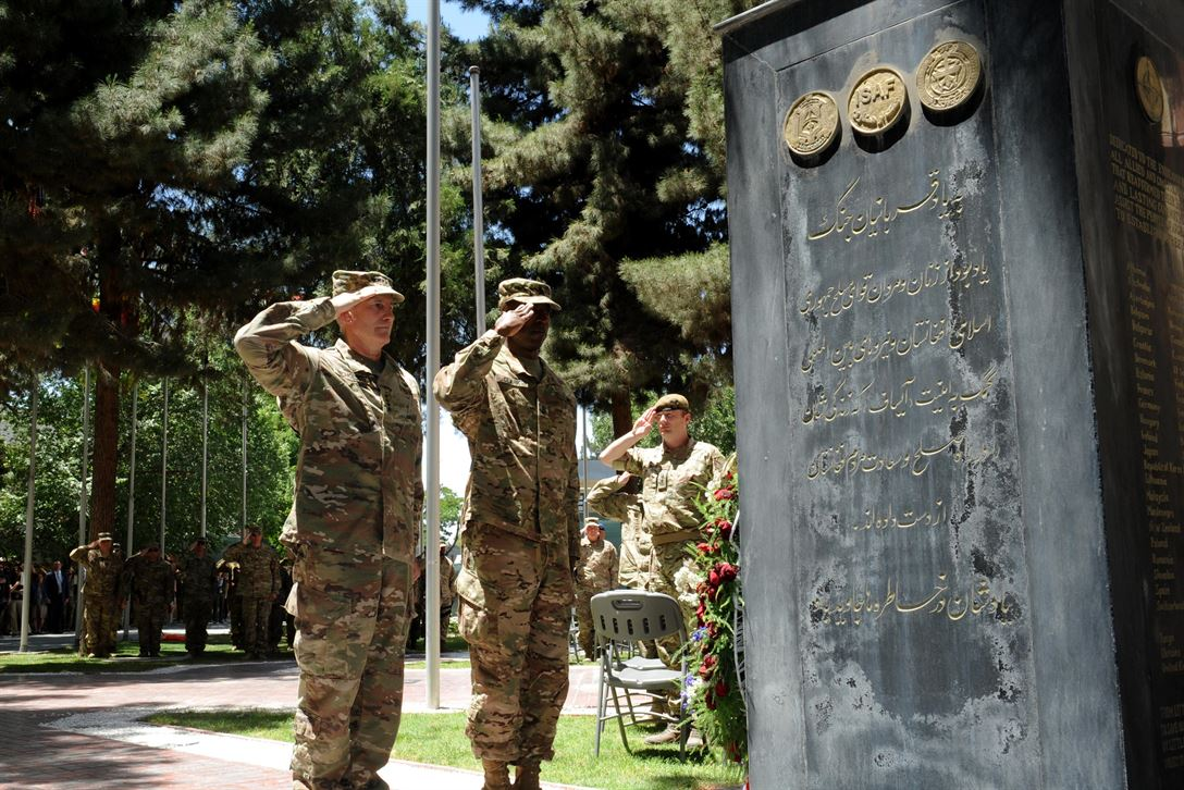 Army Gen. John Nicholson, commander of Resolute Support, pays his respects to service members who made the ultimate sacrifice in Afghanistan during a Memorial Day ceremony in Kabul, Afghanistan, May 29, 2017. Air Force photo by Tech Sgt. Robert M. Trujillo