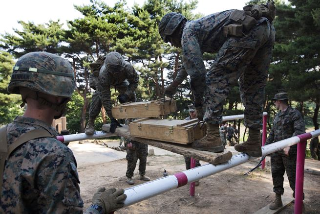 Marines and sailors participate in the Leadership Reaction Course at Camp Mujuk, South Korea, May 29, 2017. The Marines and sailors are assigned to India Company, 3rd Battalion, 8th Marine Regiment, and conduct courses like these to build confidence and communication skills within their units. Marine Corps photo by Cpl. David A. Diggs