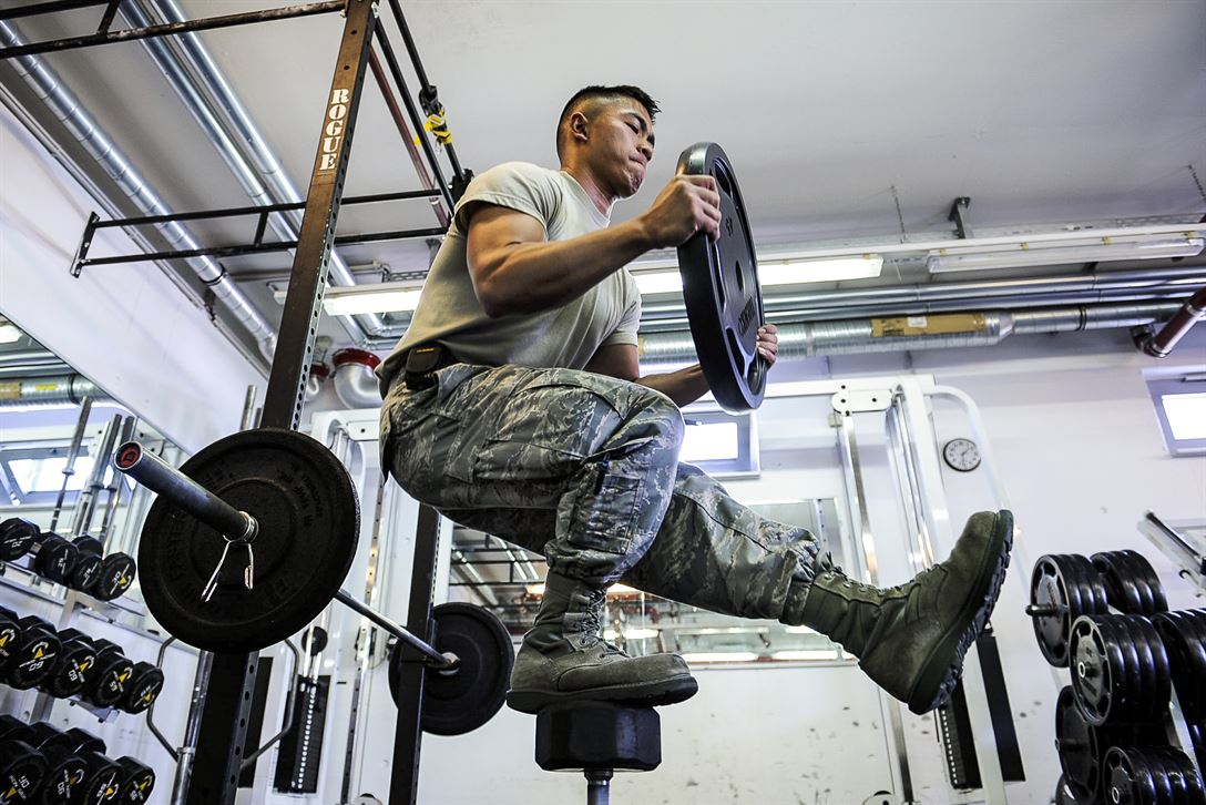 Air Force Airman 1st Class Nikko Madarang balances on one leg and squats while working out at Ramstein Air Base, Germany, June 1, 2017. Madarang is a passenger service specialist assigned to the 721st Aerial Port Squadron. Air Force photo by Airman 1st Class Savannah L. Waters