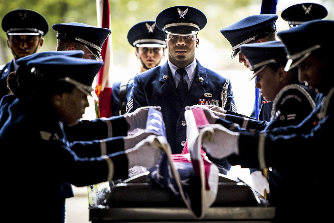 Air Force Staff Sgt. Gregory Barker presides over the flag-folding portion of the Eglin Honor Guard graduation ceremony performance at Eglin Air Force Base, Fla., June 1, 2017. Air Force photo by Samuel King Jr.