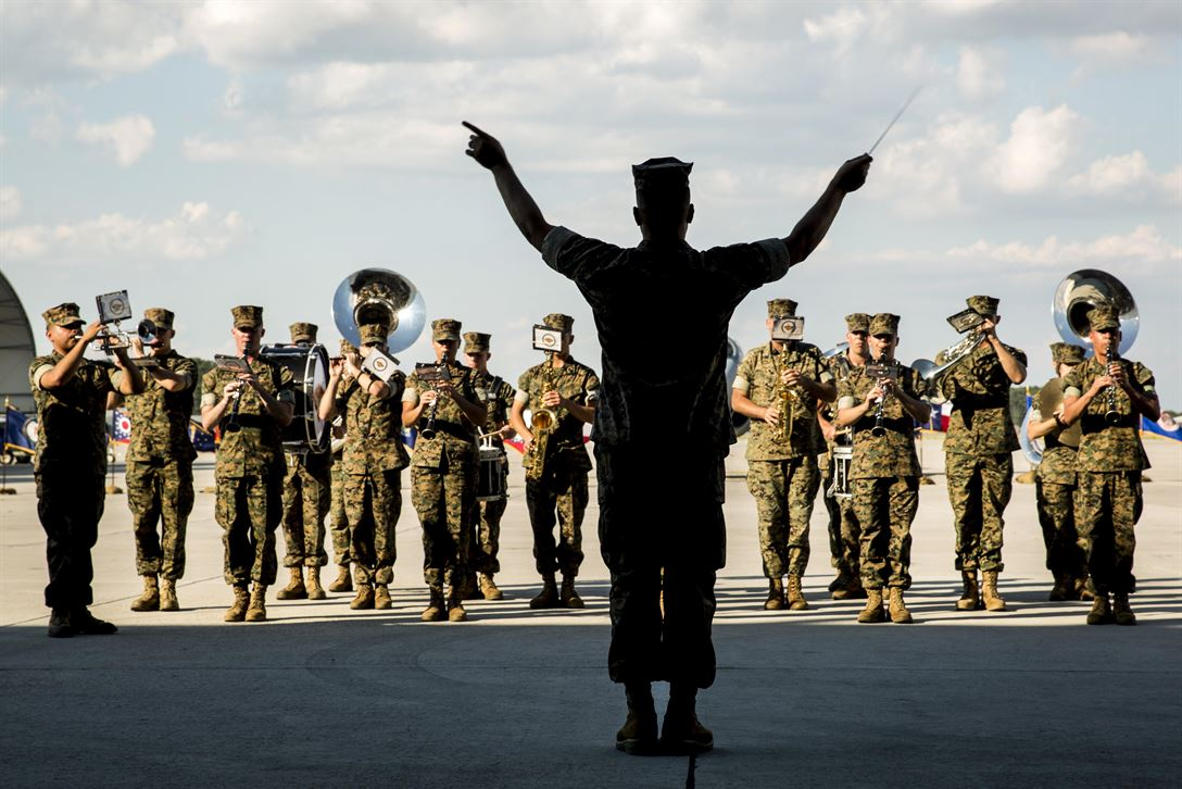A conductor directs the 2nd Marine Aircraft Wing band during a deactivation ceremony for Marine Tactical Electronic Warfare Squadron 4 at Marine Corps Air Station Cherry Point, N.C., June 2, 2017. The squadron deactivated after supporting the 2nd Marine Aircraft wing for 35 years. Marine Corps photo by Lance Cpl. Jailine L. Martinez